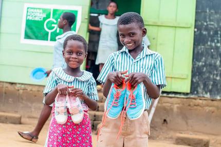 Children recieving shoes